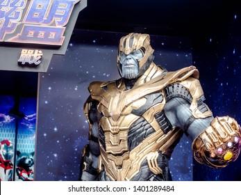 Taipei, Taiwan - May 16, 2019: Thanos full armor suit action figure show for promote Avengers endgame movie at street shot of Taipei Nan Shan Plaza near Taipei 101.
