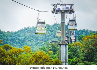 Taipei, Taiwan - May 16, 2019 : Maokong gondola with mountain around. A gondola lift transportation system in Taipei opened in 2007. operates between Taipei Zoo and Maokong.