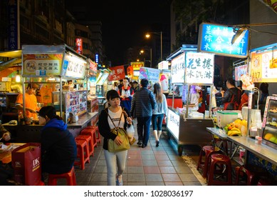 Taipei, Taiwan - May 17, 2016 : Street food vendors in the famous Shilin night market, a popular travel destination in Taipei on May 17, 2016 in Taipei