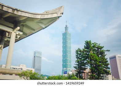 Taipei, Taiwan - May 17, 2019 : Statue of Sun Yat-sen at the National Sun Yat-sen Memorial Hall, with view of Taipei 101 building in background.