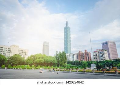 Taipei, Taiwan - May 17, 2019 : Gardens at the National Sun Yat-sen Memorial Hall and Taipei 101, in the Xinyi District, Taipei, Taiwan.