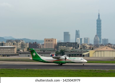 TAIPEI, TAIWAN - MAY 18, 2019: UNI Air ATR ATR-72-600 landing to the Taipei Songshan Airport in Taipei, Taiwan.