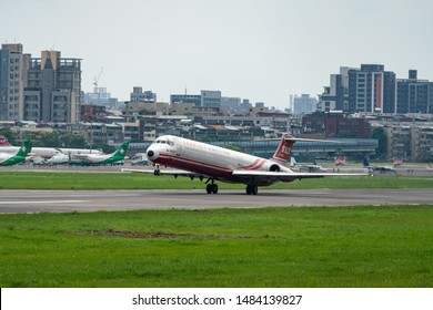 TAIPEI, TAIWAN - MAY 19, 2019: Far Eastern Air Transport (FAT) McDonnell Douglas MD-83 taking off from the Taipei Songshan Airport in Taipei, Taiwan.