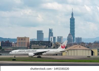 TAIPEI, TAIWAN - MAY 19, 2019: JAL Boeing 777-200ER taxing at the Taipei Songshan Airport in Taipei, Taiwan.