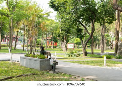 TAIPEI TAIWAN - MAY 19: Homeless man sleeping live in public park of Taipei district May 19, 2018. There isn't enough welfare program of Taiwan government to help the poor.