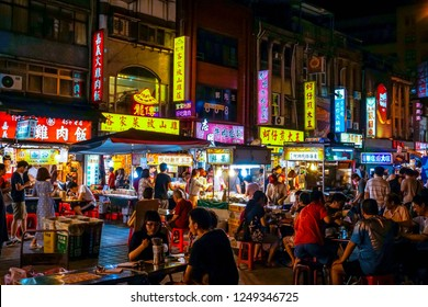 Taipei, Taiwan - MAY 2016: Many people eating & drinking in Ningxia Road Night Market, a famous snack street in Taipei City
