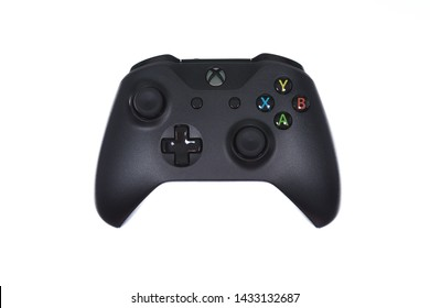 Taipei, Taiwan - May 31, 2019: A floating black Microsoft XBOX One controller isolated on a white background