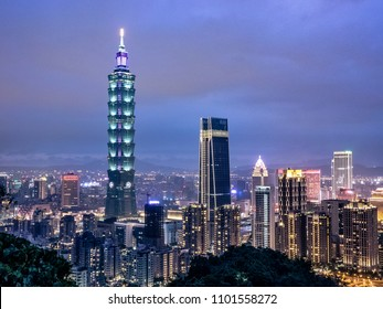 Taipei, Taiwan - May 5, 2018: Night skyline of Aerial panorama over Downtown Taipei with Taipei 101 Skyscraper, Landmark buildings of Taipei