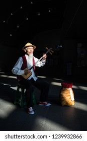 Taipei / Taiwan - Nov 16 2017: Street artist playing traditional Chinese musical intruments at MRT station