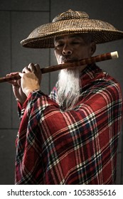 Taipei / Taiwan - Nov 21 2018: Street artist playing traditional Chinese musical intruments at MRT station