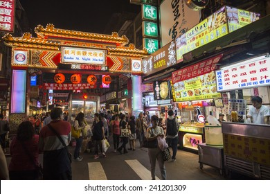 Taipei, Taiwan - November 24, 2014: People walk pass the east entrance of Raohe Street Night Market in Songshan district.