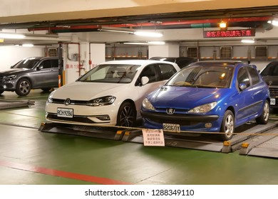 Taipei, Taiwan - November 25, 2018 : Motion of car leaving underground parking space by auto machine parking system