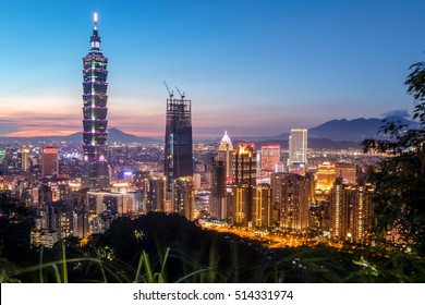 TAIPEI, TAIWAN - OCT 1: Taipei 101 building is a famous landmark in Taipei's financial district. This photo was taken at sunset from elephant mountain on Oct 1, 2014 in Taipei