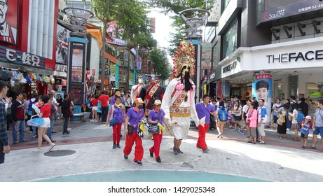Taipei, Taiwan - October 26, 2015 : View of a Chinese religious festival procession figures walking along the street at XiMenDing neighbourhood