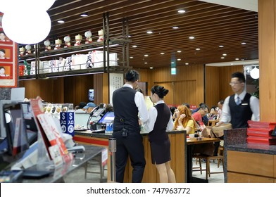Taipei, Taiwan - October 28, 2017 : Motion of people eating foods and waiter checking ordering inside Chinese restaurant.