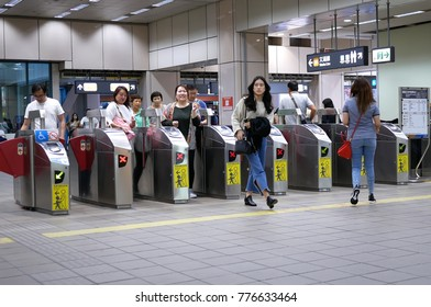 Taipei, Taiwan - October 31, 2017 : Motion of people walking through the fare pay zone for taking MRT