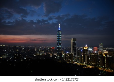 TAIPEI, TAIWAN - OCTOBER 5,2018: The Taipei city landscape viewing with 101 building landmark of Taiwan from Xianshan hill viewpoint in twilight time, Taipei