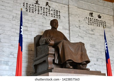 TAIPEI, TAIWAN - OCTOBER 9,2018: The statue of Chiang Kai-shek inside the Memorial Hall area with local people and traveller, Taipei