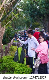 Taipei, Taiwan, Republic of China - December 22, 2018: Bird Watchers in Daan Park