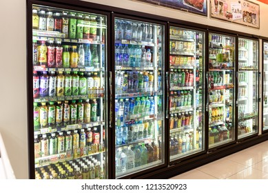 Taipei, Taiwan. September 10, 2018. Various types and brands of drinks of fruit juice, tea, coffee and milk in the refrigerated units of a Family Mart convenience store.
