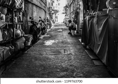 Taipei, Taiwan - September 17, 2018: A woman reading a book in the streets of Taipei.