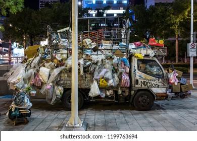 Taipei, Taiwan - September 19, 2018: An abandoned garbage truck at night.