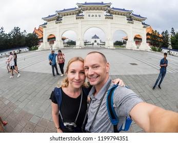 Taipei, Taiwan - September 27, 2018: Caucasian couple makes selfie in front of Kai-Check Memorial Hall.