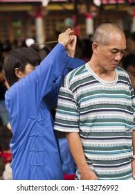 TAIPEI, TAIWAN-JUNE 13,2013:traditional asian praying for chinese god at Hsing Tian Kong on JUNE 13,2013 in Taipei,Taiwan