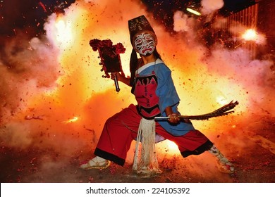 TAIPEI,TAIWAN - JUNE 22 : The folk-custom acrobatics in the temple fair of township on June 22, 2014 in Taipei ,TW. Eight Generals sat in the firecracker at the junction fire in Dai Tianfu pilgrimage