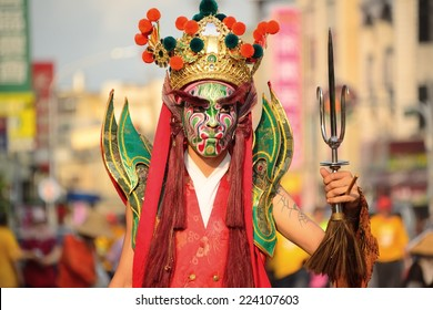 TAIPEI,TAIWAN - MARCH 29 : The folk-custom acrobatics in the temple fair of township on MARCH 29, 2014 in Taipei ,TW. Traditional troupes Eight Generals painted faces participate in the parade