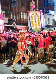 TAIPEI,TAIWAN - MAY 29 : The folk-custom acrobatics in the temple fair of township in night on May 29,2017 in Tamsui,Taipei,Taiwan. The fair held annually on chinese lunar date of sixth in May.