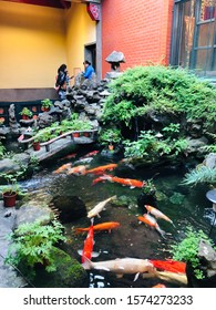 """Taipei/Taiwan-11/18/2019: Xingtian Temple is devoted to the God of War """"Guangong"""". It's said garden's fishes in the temple are spirited. If you talk to them, you fell relaxation."""