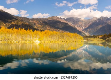 Taisho Pond in Kamikochi in Nagano Prefecture, Japan.It is beautiful with the autumn leaves and the Hodaka mountain range reflected.
