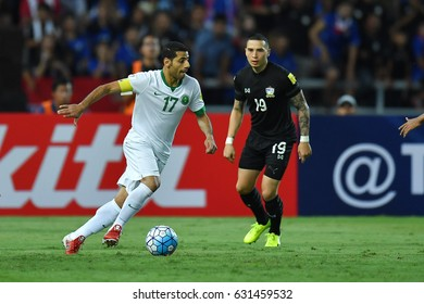 Taisir Al-Jassimg (L) of Saudi Arabia in action during 2018 FIFA World Cup Qualifier Group B between Thailand and Saudi Arabia at the Rajamangala Stadium on March 23, 2017 in Bangkok,Thailand,