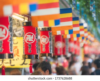 Taito, Tokyo / Japan - August18th 2013: Alignement view of the red lanterns of the Asakusa Temple with while religious swastikas. Located in Tokyo this Buddhist Temple is the oldest temple of Tokyo.