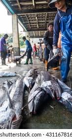 Taitung, Taiwan - May 28, 2016 : Fishing boats docked Chenggong Fishing Harbor remove fishing goods