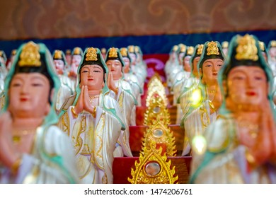 TAIWAN, CHINA - July 14, 2019: Buddhist temple in Taiwan, artsy interior Guandu Temple, many statues of Buddha deities in rows