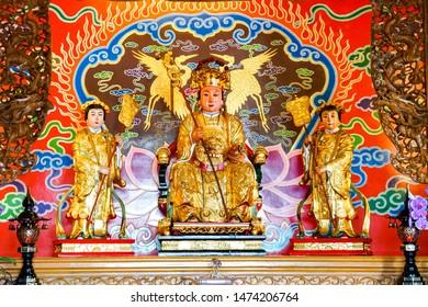 TAIWAN, CHINA - July 14, 2019: Buddhist temple in Taiwan, artsy interior Guandu Temple, gold statues of Buddha deities