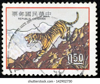TAIWAN - CIRCA 1973:  A stamp printed in Taiwan shows a traditional Chinese painting of tiger to celebrate the Chinese Tiger Year, circa 1973