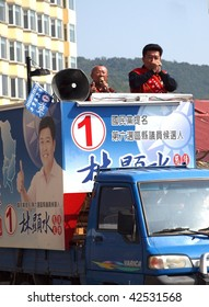 TAIWAN - DECEMBER 5: Election candidates parade through the streets in trucks ahead of next day's vote on December 5, 2009 in Taiwan.