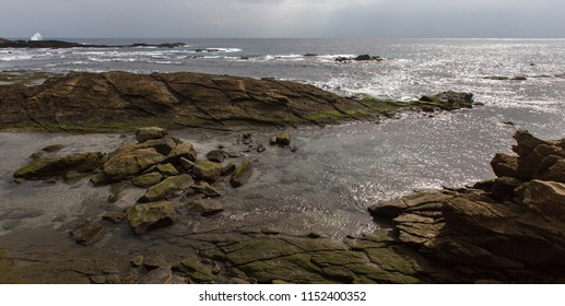 Taiwan East Coast Rocky Coastline Background Image - Overcast Skies, Exotic Rock Formations, Grass and Waves in the Ocean. Ocean Coastline, Asia Landscape Photography, Rays of sunshine in background
