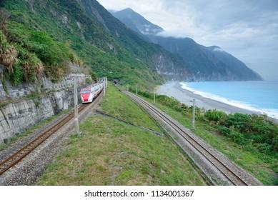Taiwan, Hualian-January 31, 2015: A two-way train track and tunnel along the coastline near the Hualian cliff.