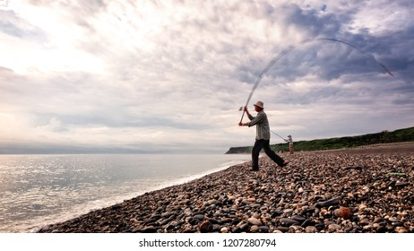 TAIWAN, HUALIEN, QIXINGTAN BEACH, MAY 2013: An unidentified man casts his fishing rod into the ocean. Qixingtan Beach in Hualien is where the mountains meet the sea. A popular local destination.