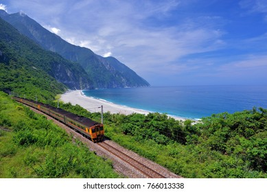 Taiwan, Hualien, the train is driving under the blue sky and the cliff cliff coastline is a beautiful picture.