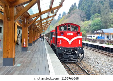 Taiwan Jiayi-March 17, 2015: The red train stops at the Alishan railway station platform in Taiwan and is a happy journey.