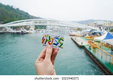 TAIWAN, KAOHSIUNG - 7 February 2018. The iPASS is a contactless smartcard operated in Taiwan and accepted for virtually all public transport, shown in front of Kaohsiung city skyline