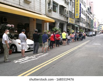 TAIWAN, KAOHSIUNG -- MARCH 27, 2020: People stand in line to receive their weekly face mask rations.