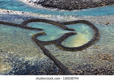 Taiwan Landmark Twin Hearts Stone Tidal Weir in Chimei Taiwan scenery
