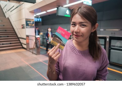 Taiwan March 02 2019.Asian woman holding and show ticket Taiwan high speed rail(HSR) at taipei station.