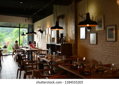 Taiwan Miaoli-April 21, 2018: Warm retro atmosphere of the restaurant, outside the glass is the landscape of greenery.